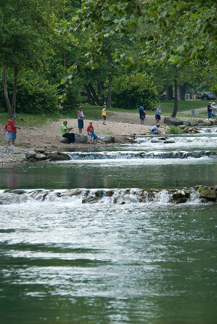 People fishing in the river at Roaring River State Park