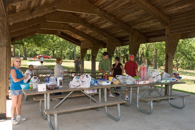 People gathered under one of the picnic shelters