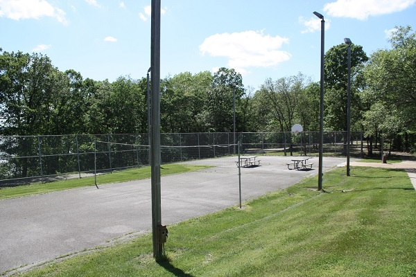 paved play court with volleyball net